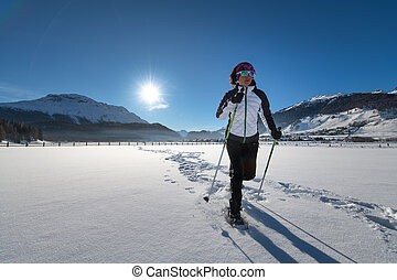 Snowshoe ride in a snowy expanse on the Alps