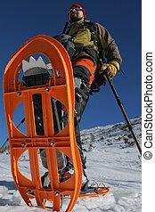 Snowshoe trip. Winter outdoor activity