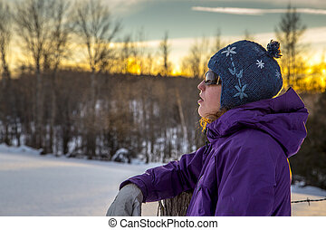 Snowshoeing Woman in Winter Outdoors at Sunset
