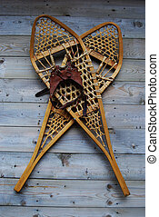 Snowshoes - old snowshoes hanging on wall
