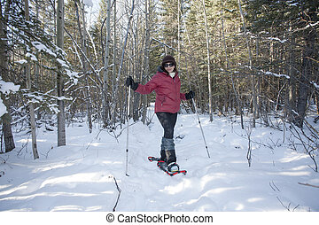 snowshoing in the forest