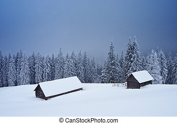 Snowstorm in the mountains - Winter landscape with a hut in ...