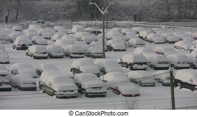 Snowstorm parking lot. Two shots.