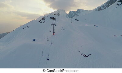"""Snowy Alps, popular resort for extreme sports, snowgroomer..."