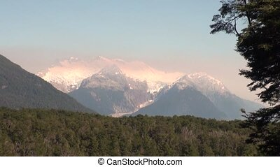 Snowy and green mountains in sunlight of Argentina.