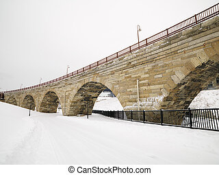 Snowy bridge scene.