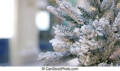Snowy christmas tree in department store - Fir tree covered...