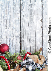 Snowy Christmas Trimmings against White Rustic Background