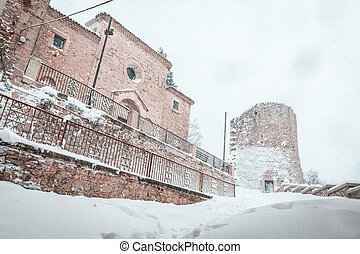 snowy church and tower in Campobasso