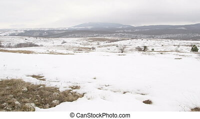 Snowy Crimean mountain plateau, pan shot