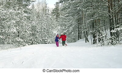 Snowy Forest - Slow-motion of cheerful children running...