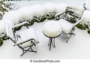 snowy garden furniture, symbol of winter, winter break, a...