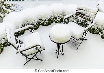 snowy garden furniture, symbol of winter, winter break, a...