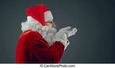 Snowy Greeting - Side view of aged man in Santa Claus...
