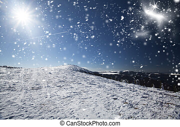 Snow covered hillside in the high mountains in bright sunshine