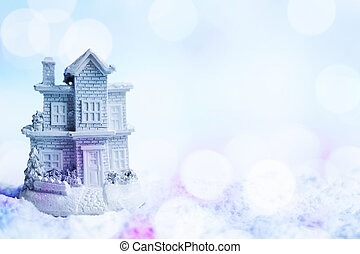 Snowy house in the snow with colorful bokeh effect.