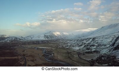 Iceland snowy mountains landscape aerial view from above drone flight footage