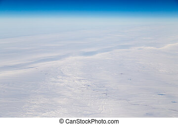 snowy land. view from the airplane as background