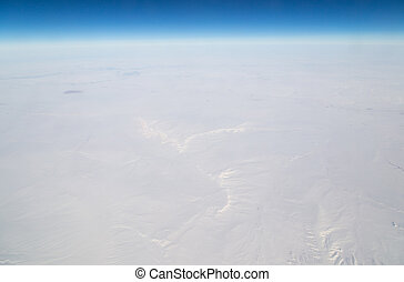 snowy land. view from the airplane