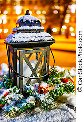 Snowy lantern at the Vilnius Christmas Market in Lithuania reflex