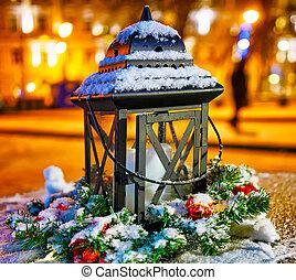 Snowy lantern on the Vilnius Christmas Market in Lithuania reflex