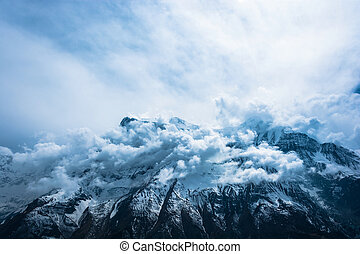 Snowy mountain peaks and white clouds, Nepal. - Snowy...