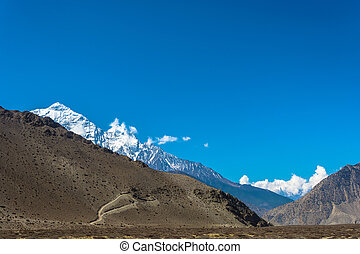 Snowy mountain peaks in the Himalayas, Nepal. - Snowy...