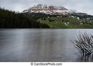 Snowy Mountain Peeks Out Across Beartooth Lake in Absaroska Wilderness