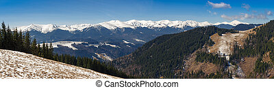 snowy mountain range in the light of the sun. early spring in the mountains