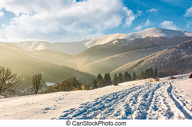 snowy mountain ridge above the rural area. lovely...