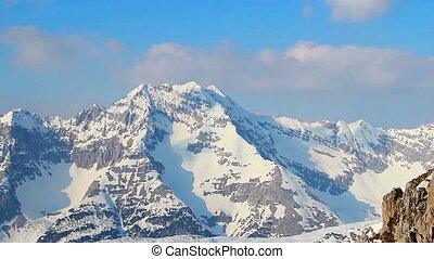 Snowy mountain ridge panorama, bright blue sky in Austrian...