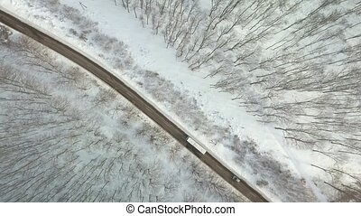 Snowy mountain road by bus