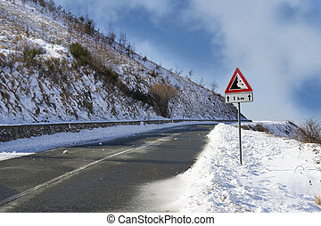 snowy mountain road in Italy