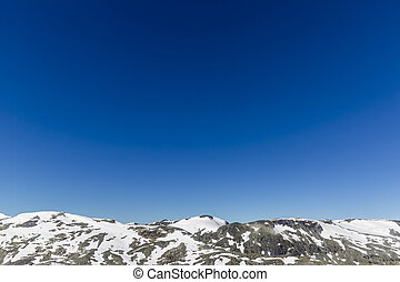 Snowy mountains against the blue sky