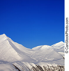 Snowy mountains and blue clear sky at nice morning