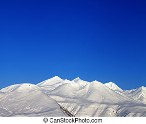 Snowy mountains and blue clear sky  in morning