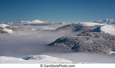 Snowy Mountains and Clouds Timelapse - clouds are flowing...
