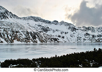 Snowy mountains and frozen lake 3