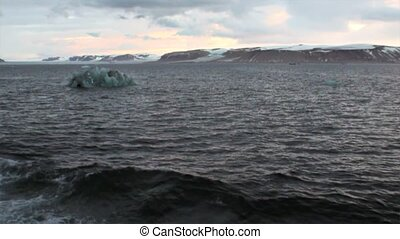 Snowy mountains and ice view from bow ship in Arctic Ocean...