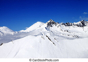 Snowy mountains at nice day. Caucasus Mountains, Georgia,...