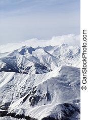Snowy mountains in haze. Caucasus Mountains, Georgia,...