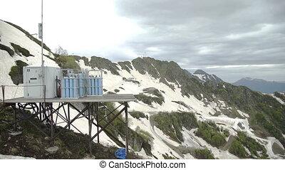 Snowy mountains in spring. Aerial shot of ski resort