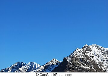 Snowy mountains - Snowy Alps mountains on blue sky, Italy, ...