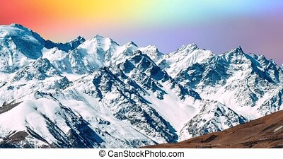 snowy mountains with bright and unusual clouds.