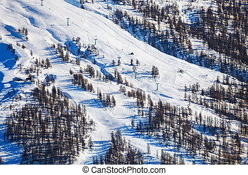 Snowy mountains with steep slopes at ski resort