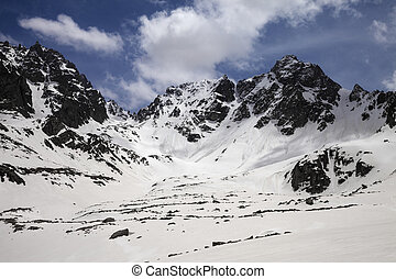 Snowy mountains with traces from avalanche
