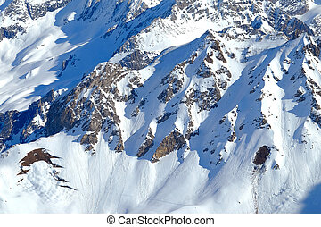 snowy mountainside - a snow covered rocky mountainside