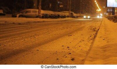 Snowy Night Avenue Traffic - Abundant snow begins to settle...