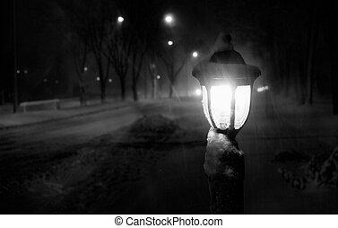 snowy night blizzard streetlight