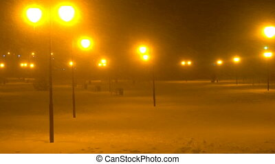 snowy Park with benches and lights by night, snow falling ,snowfall
